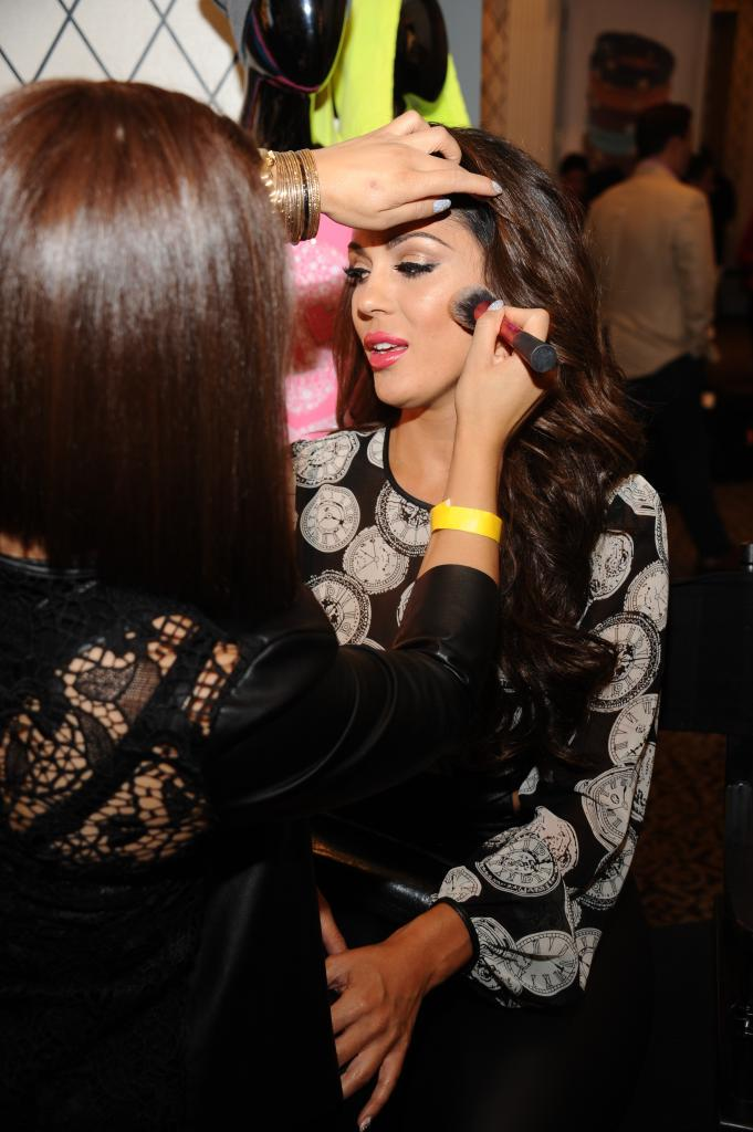 Carisssa Rosario International Maxim Model getting her makeup touched up my Hard Candy at the Empire Hotel Gifting suite.