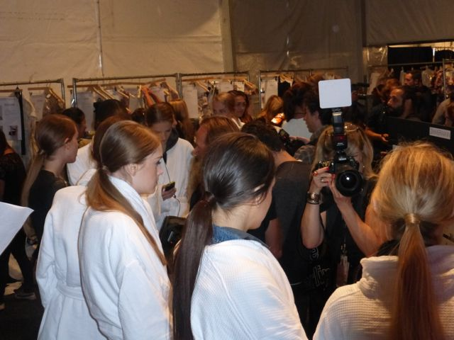 Backstage Zimmermann show New York Fashion week girls hair is in a long ponytail. NYFW 2013 Hair Trends Zimmermann.