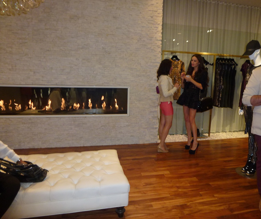 Socializing with guests at the Herve Leger Barbie launch event at the Melrose Boutique in Los Angeles.