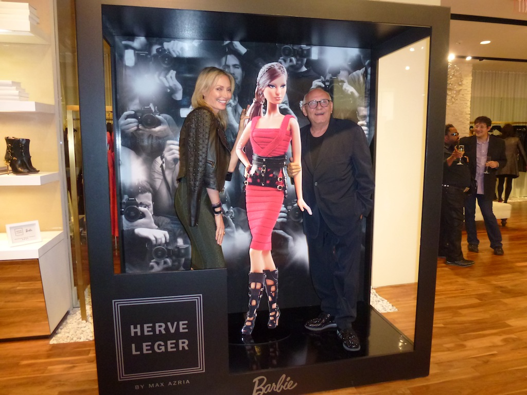 Lubov and Max Azria pose with Life Size Barbie at Launch of Herve Leger by Max Azria Barbie Doll Collection