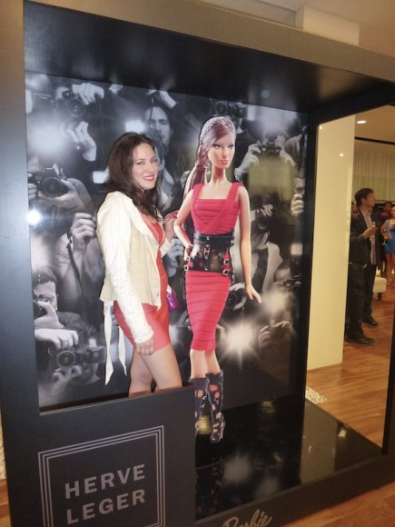 Posing with Herve Leger Barbie doll wearing the red bandage dress and alligator boots!! Herve Leger Glam girl.