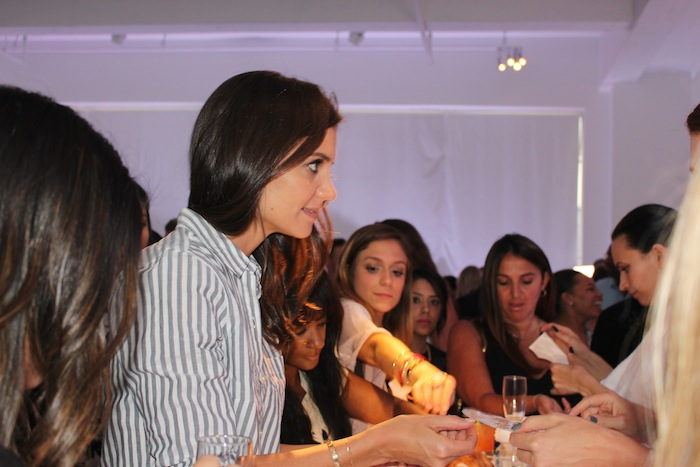 Katie Holmes gets temporary tattoo at Old Navy Fashion Week Party