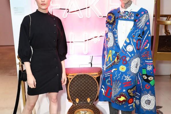 Evan Rachel Wood and artist Illma Gore pose next to Louis Vuitton Toilet in LA