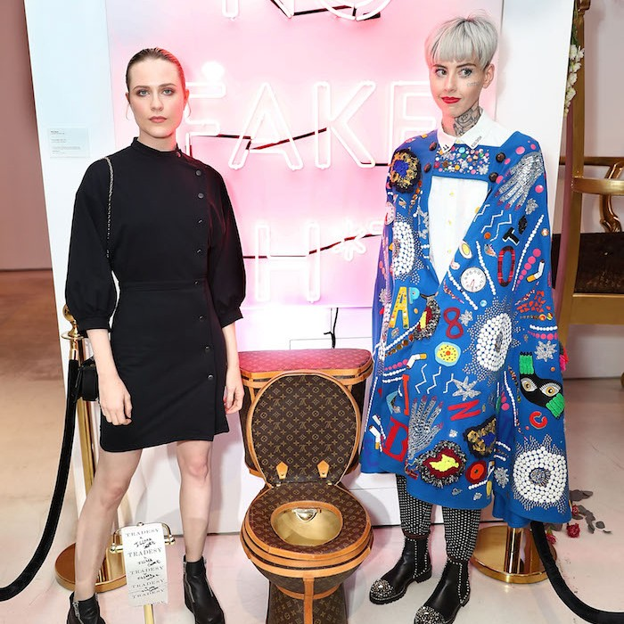 Evan Rachel Wood and artist Illma Gore pose next to Louis Vuitton Toilet in LA
